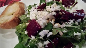 Salad: Roasted Beets with Goat Cheese and Pine Nuts over Arugula and Mache (Photo Credit: Adroit Ideals)