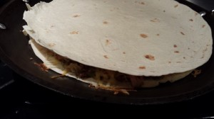 Top the filling with a flour tortilla (Photo Credit: Adroit Ideals)