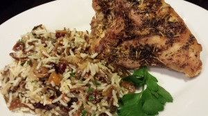 Wild Rice Salad with Dried Apricots and Cranberries accompanies a baked Herbed Chicken Breast (Photo Credit: Adroit Ideals)