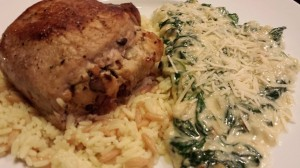 Stuffed Pork Chop, Rice Pilaf, and Creamy Spinach and Arugula (Photo Credit: Adroit Ideals)