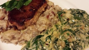 A side of Garlicky Creamed Spinach and Arugula.  Served with a Rice Medley which is topped with a Seared Pork Chop in a Sherry Sauce.  (Photo Credit: Adroit Ideals)