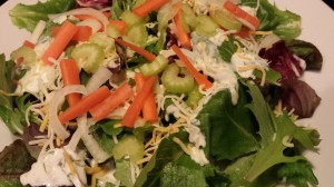Super easy weeknight side salad of spring mix, celery, carrots, sweet onion, Herby Buttermilk Dressing and shredded cheese.  (Photo Credit: Adroit Ideals)