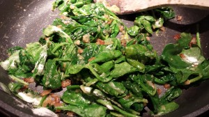 Stir the spinach until coated with the flour (Photo Credit: Adroit Ideals)