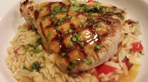 Grilled Tuna with Orange Ginger Sauce served over Orzo with Dates, Red Bell Pepper, and Shallots (Photo Credit: Adroit Ideals)