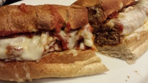 Slice into a cheesy gooey tomatoey meatball sandwich!  (Photo Credit: Adroit Ideals)
