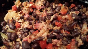 Smoked Pulled Pork, Black Beans, Caramelized Onions, Red Bell Pepper, and Minced Garlic combine for a tasty enchilada filling (Photo Credit: Adroit Ideals)