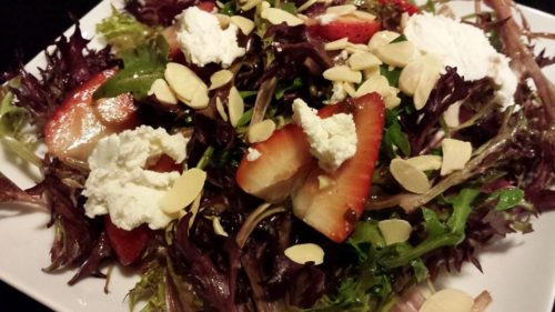 salad with strawberries, almonds, and goat cheese