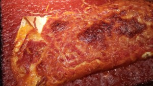 Homemade Red Enchilada Sauce smothers a Baked Cheese Enchilada (Photo Credit: Adroit Ideals)