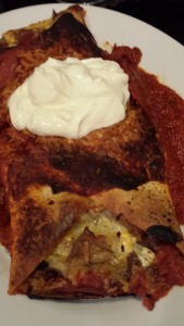 Smoked Pork Enchilada served with a dollop of Sour Cream (Photo Credit: Adroit Ideals)