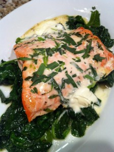 Baked Salmon with Lemony Creme Fraiche and Tarragon over a bed of sauteed Spinach  (Photo Credit: Adroit Ideals)