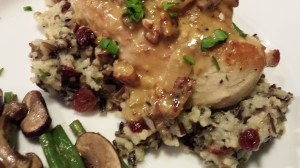 Seared Chicken Breast over Wild Rice Medley with a Cognac Pan Sauce and a side of Haricots Verts with Mushrooms (Photo Credit: Adroit Ideals)