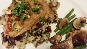 A tasty Wild Rice Medley topped with a Chicken Breast lapped with a Cognac Sauce.  Side of Sauteed Green Beans and Mushrooms. (Photo Credit: Adroit Ideals)