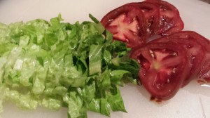 Shredded lettuce and sliced ripe tomato (Photo Credit: Adroit Ideals)