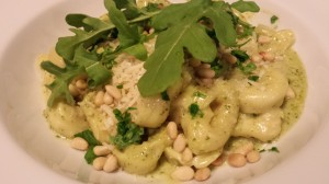 Creamy Basil Arugula Pesto Sauce over Tortellini with Toasted Pine Nuts, Shredded Parmesan, Chopped Basil, and Arugula (Photo Credit: Adroit Ideals)