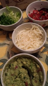 Fajita Fixin's:  Homemade Guacamole and Pico de Gallo.  Shredded Monterey Jack and Lettuce.  (Photo Credit: Adroit Ideals)