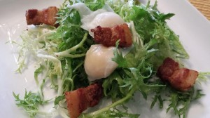 Hubby's Salade Lyonnaise with Frisee, Lardons, and Poached Quail Eggs, dressed with Dijon Mustard Dressing (Photo Credit: Adroit Ideals)
