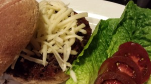 Spicy Black Bean Burger and Shredded Monterey Jack Cheese on a Toasted Bun with Lettuce and Tomato (Photo Credit: Adroit Ideals)