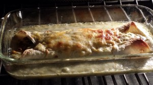 Bake the roasted corn enchilada until the cheese has browned and the creamy salsa verde sauce is bubbling  (Photo Credit: Adroit Ideals)