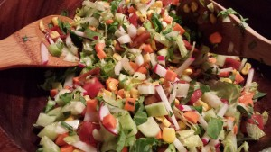 Toss the chopped salad with the dressing (Photo Credit: Adroit Ideals)