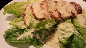Grilled Chicken over a Whole Leaf Caesar Salad and generous sprinkling of Shredded Parmesan (Photo Credit: Adroit Ideals)