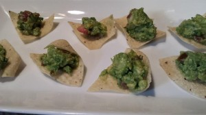 Guacamole on tortilla chips is an easy bite-sized party appetizer  (Photo Credit: Adroit Ideals)