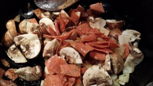 Saute the onions, garlic, pepperoni, and mushrooms (Photo Credit: Adroit Ideals)