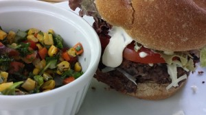 Spicy Black Bean Burger with Garlic Aioli served with a Chopped Veggie Salad (Photo Credit: Adroit Ideals)