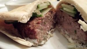 Lamb Meatballs served in a pita with cucumbers and Greek yogurt sauce ...