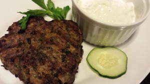 Grilled Lamb Meatball Patties with a side of Greek yogurt sauce (Photo Credit: Adroit Ideals)