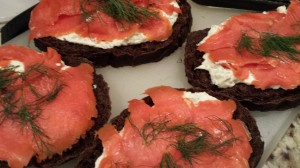 Layer the smoked salmon slices over the herbed cream cheese (Photo Credit: Adroit Ideals)