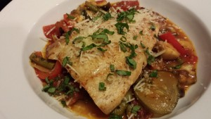 Seared fish fillet over a bed of summer ratatouille (Photo Credit: Adroit Ideals)