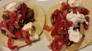 Pork Carnitas Tacos topped with Pico de Gallo and Sour Cream (Photo Credit: Adroit Ideals)
