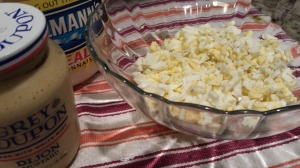 Mayonnaise and dijon mustard help bind the egg salad together (Photo Credit: Adroit Ideals)
