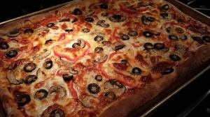 Pepperoni, red bell pepper, onion, mushroom, black olive, mozzarella, parmesan,  and herbed crust pizza just out of the oven. (Photo Credit: Adroit Ideals)
