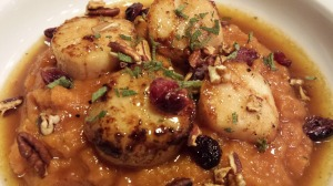 Seared Scallops over Pumpkin Butternut Squash Puree and a Calvados Butter Sauce. Topped with Dried Cranberries, Toasted Pecans, Crumbled Bacon, and Sage Chiffonade (Photo Credit: Adroit Ideals)