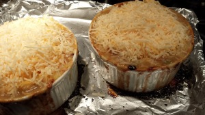 Top the baked Shepherd's Pie with the shredded cheese (Photo Credit: Adroit Ideals)