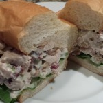Tasty Chicken Salad with Dried Cranberries, Toasted Pecans, Celery, Scallions, Dijon and Mayo with Lettuce on a Toasted Roll (Photo Credit: Adroit Ideals)