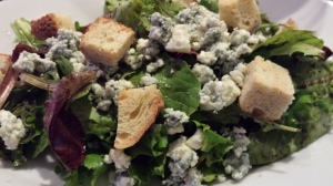 A field greens salad with bleu cheese crumbles and crispy croutons (Photo Credit: Adroit Ideals)