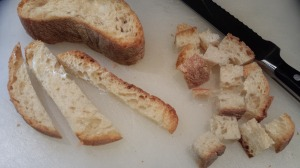 Slice your bread into cubes with a serrated bread knife (Photo Credit: Adroit Ideals)