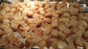 Spread the bread cubes on a baking pan (Photo Credit: Adroit Ideals)