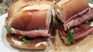 The Delaware House Sandwich: Brown Sugar Maple Ham, Swiss Cheese, Tomato, Red Onion, Arugula, Mayo, Italian Herb Seasoning, and a splash of Paul Newman's Balsamic Vinaigrette (Photo Credit: Adroit Ideals)