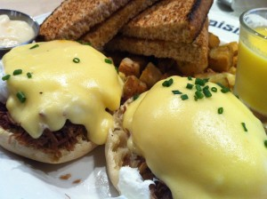 The Eggs Benedict with Duck Confit at Le Cochon Dingue in Quebec City, Quebec (Photo Credit: Adroit Ideals)