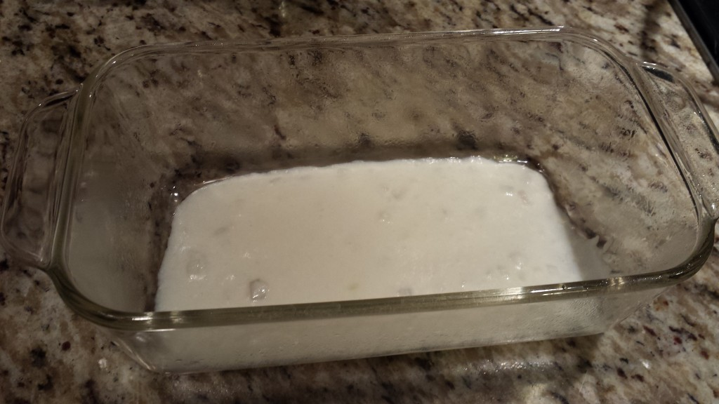 Coat the bottom of the greased glass loaf pan with white sauce  (Photo Credit: Adroit Ideals)