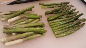 Cut the asparagus spears in half and discard the tough bottom halves. (Photo Credit: Adroit Ideals)