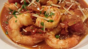 Savory Smoky Shrimp in Spicy Tomato Sauce over Garlicky Polenta (Photo Credit: Adroit Ideals)