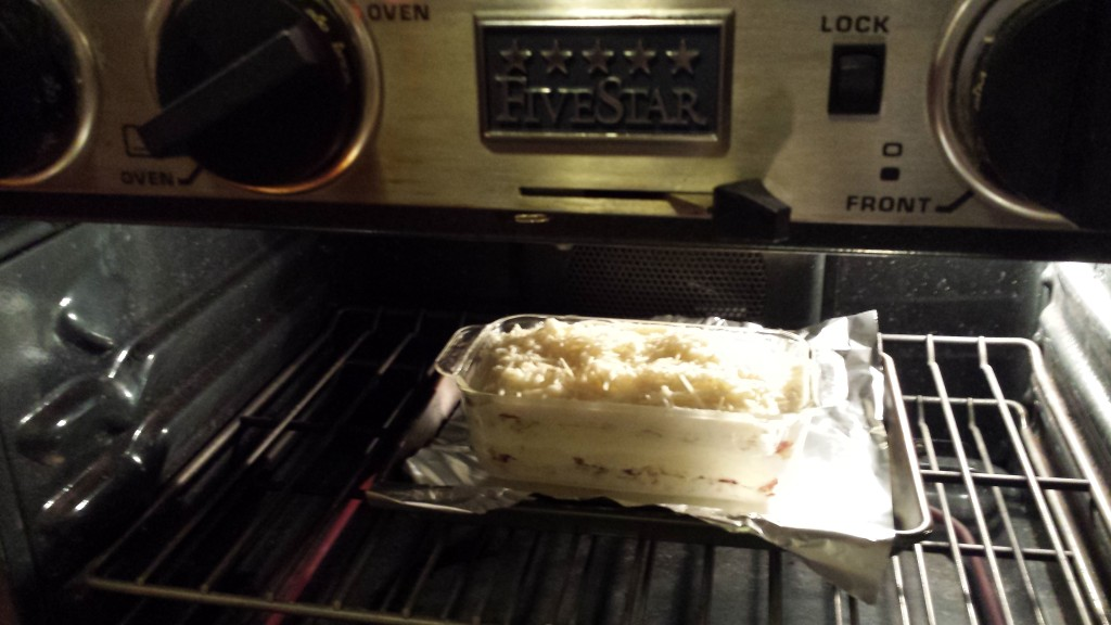 Put the white lasagna into the oven and bake  (Photo Credit: Adroit Ideals)