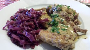 A very French bistro meal of Rabbit in Mustard Sauce and Braised Red Cabbage (Photo Credit: Adroit Ideals)