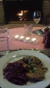 Rabbit in Mustard Sauce and Braised Red Cabbage in front of the fireplace (Photo Credit: Adroit Ideals)