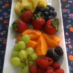 A colorful fresh fruit platter is a healthy option (Photo Credit: Adroit Ideals)