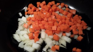 Saute the onion and carrot  (Photo Credit: Adroit Ideals)